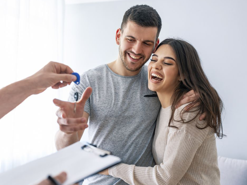 Couple excited about buying their first home